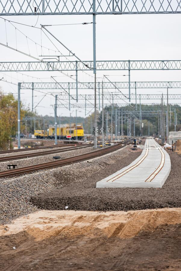 Modernization of the railway line. New track, crushed stone, railway sleepers, poles, trusses and energy infrastructure. stock photography