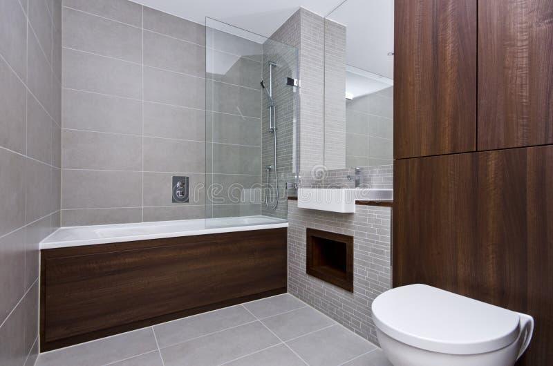 Modernt badrumfölje för tre stycke fotografering för bildbyråer