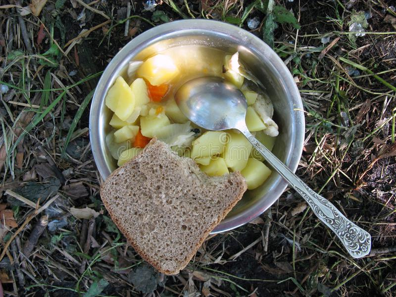 Modest food on a hike - stewed potatoes in an iron bowl and Russian, brown bread stock photos