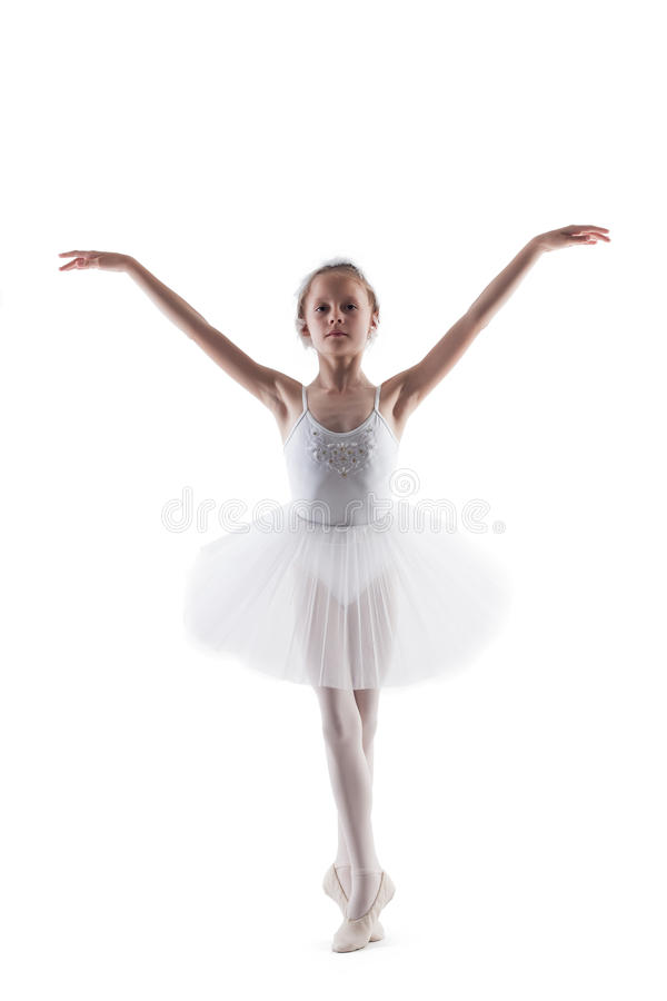 Modest little ballerina posing as White Swan stock image