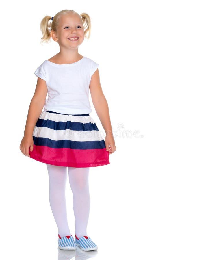 Modieus meisje in een kleding royalty-vrije stock afbeeldingen