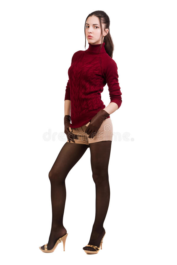 Modieus meisje in rood over wit stock fotografie