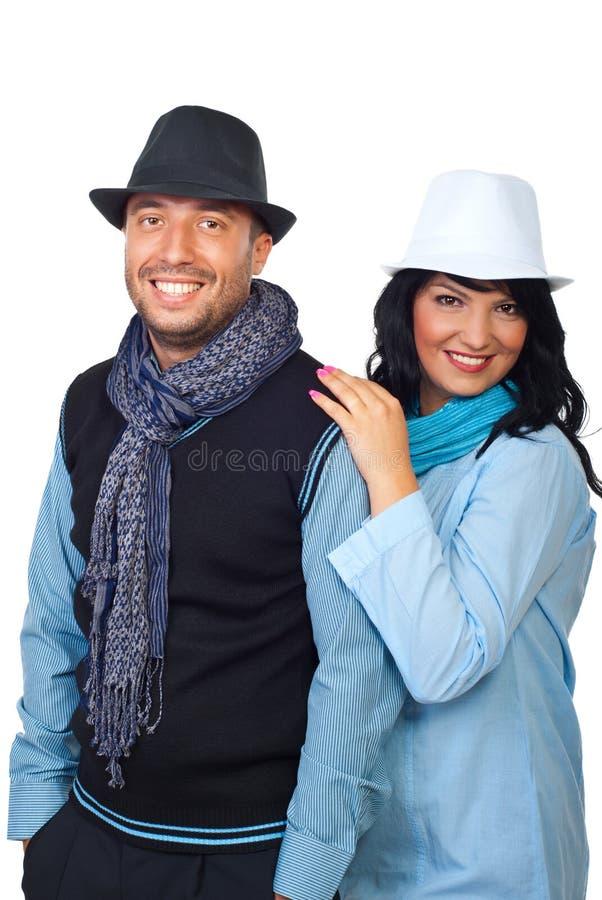 Modieus paar met hoeden stock fotografie