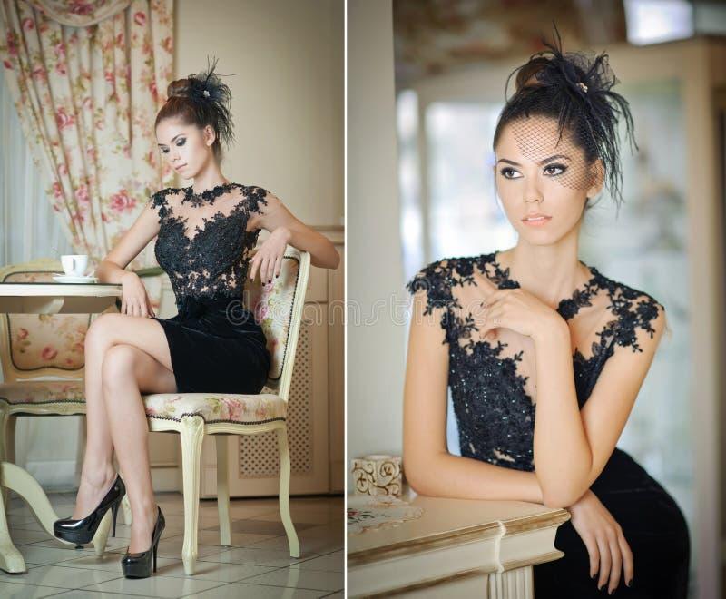Modieuze aantrekkelijke jonge vrouw in zwarte kledingszitting in restaurant Het mooie donkerbruine stellen in elegant uitstekend  royalty-vrije stock foto