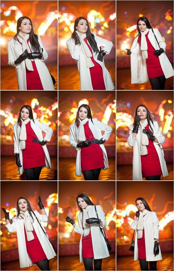 Modieuze dame die rode kleding en witte laag openlucht in stedelijk landschap met stadslichten dragen op achtergrond Volledig len royalty-vrije stock afbeelding