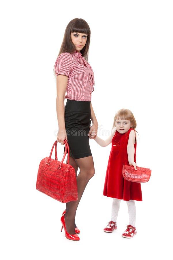 Modieuze Mamma en haar weinig dochter stock foto's