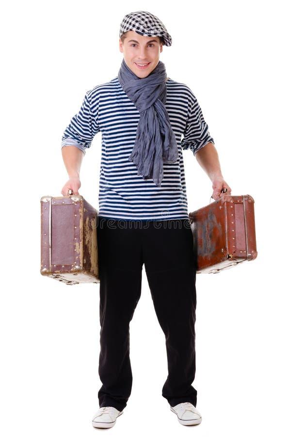 Modieuze reizigersmens met uitstekende koffer royalty-vrije stock afbeelding
