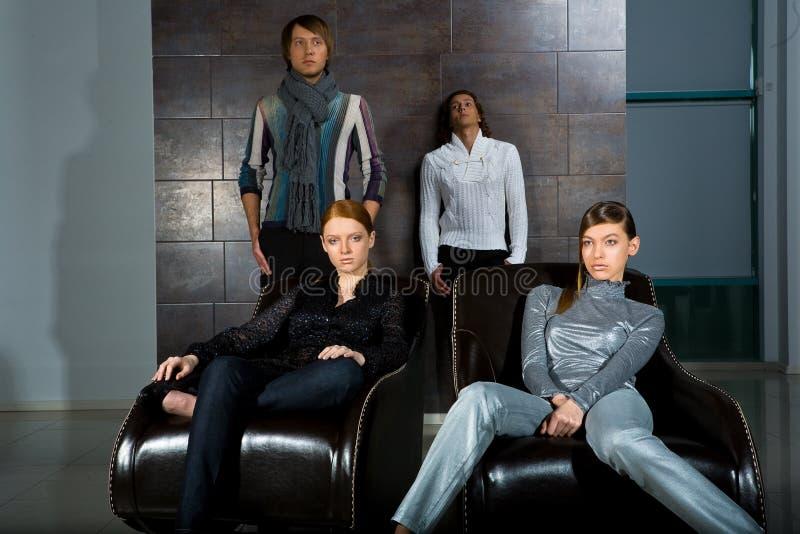 Modieuze vier mensen in de ruimte royalty-vrije stock afbeelding