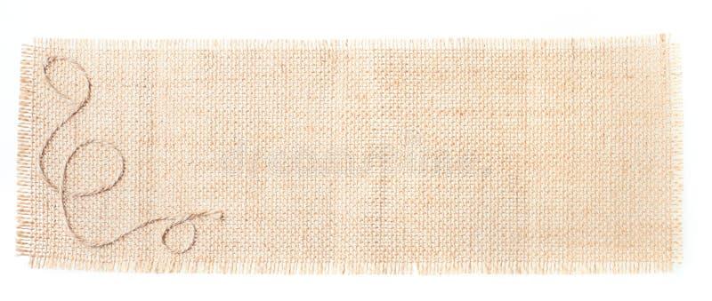 Modifica della tela di sacco con la decorazione sopra bianco immagini stock