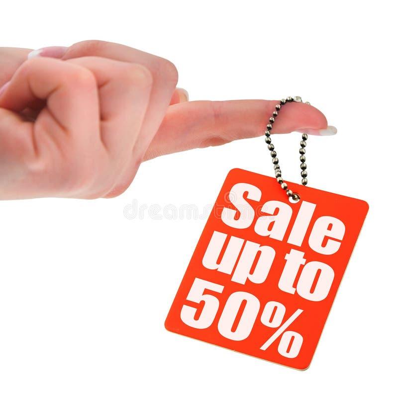 Modifica di vendita della holding della mano immagini stock libere da diritti