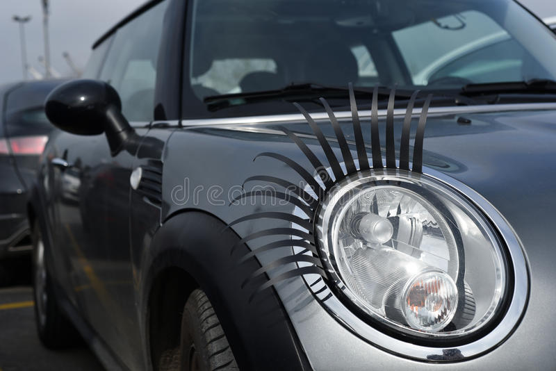 Modified Headlights of A Mini with Fake Eyelashes stock photography