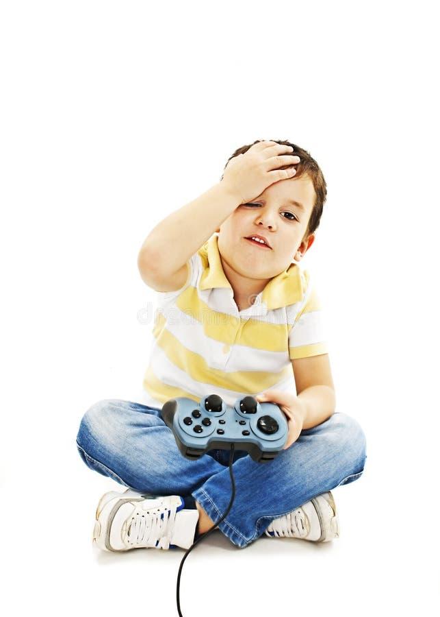 modig användande video för pojkekontrollant royaltyfri bild