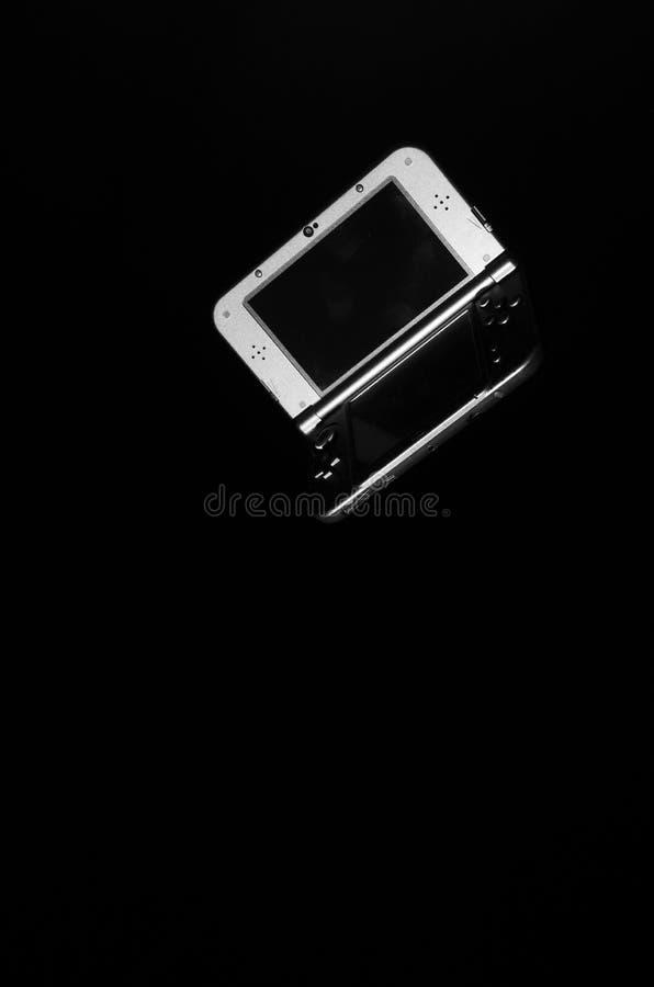 Modig konsol på en svart bakgrund royaltyfria foton