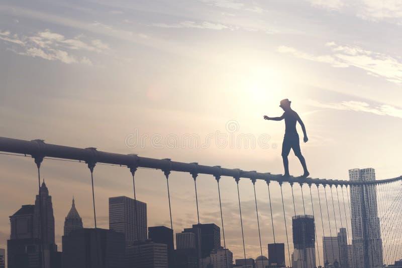 Modig pojke som går på en tråd ovanför metropolisen, begreppsmässig bild royaltyfri bild