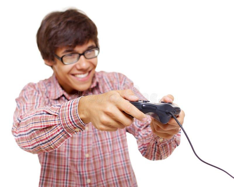 modig styrspak som leker den teen videoen royaltyfri fotografi