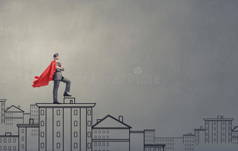 Modig toppen hjälte arkivbild