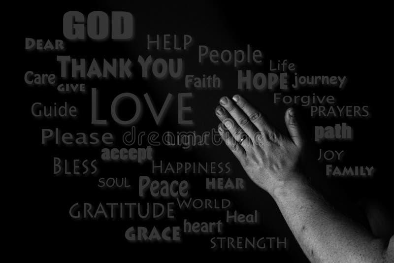 Modlić się ręki słowa chmurę Ręki mężczyzna modlenie w zmroku obrazy stock
