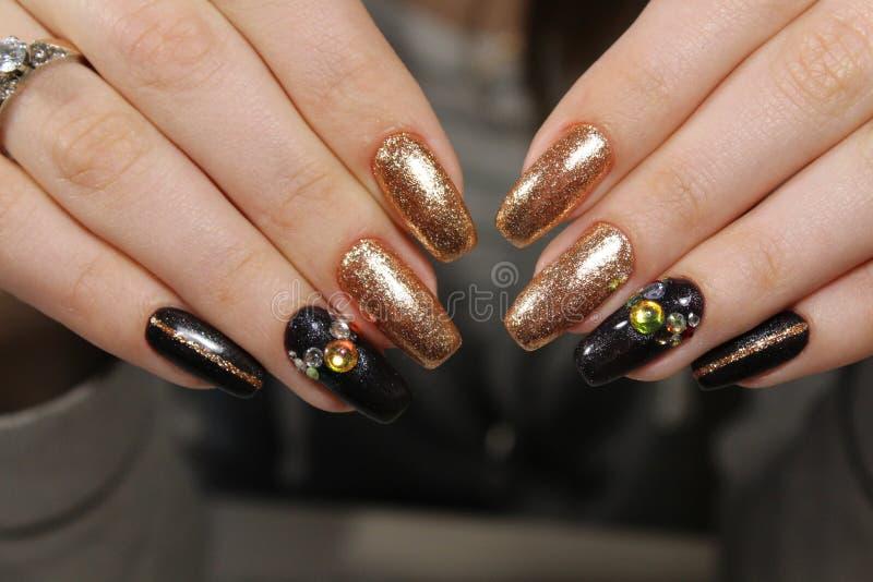 modny złoty manicure obraz royalty free