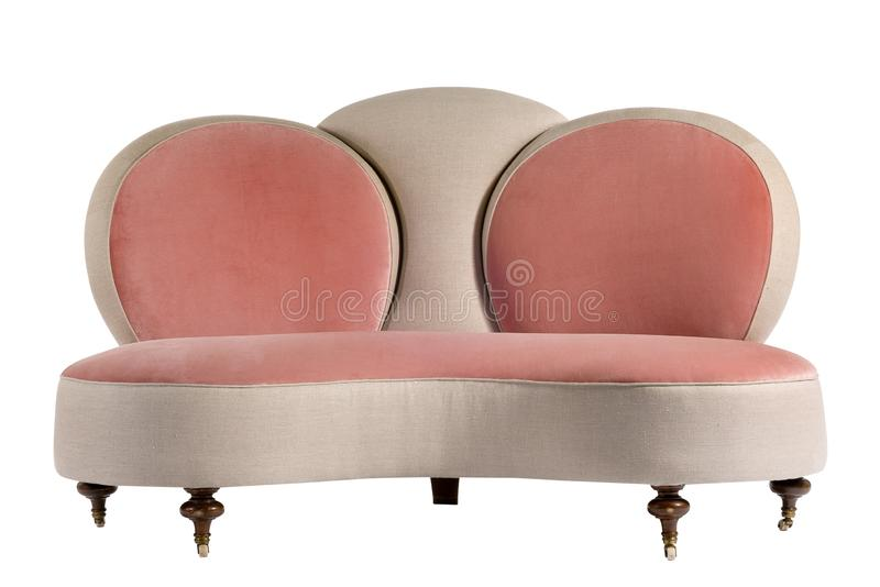 Modular bright pink beige colour sofa couch. Sixtie or seventies unusual circular backed sofa couch isolated on white stock image