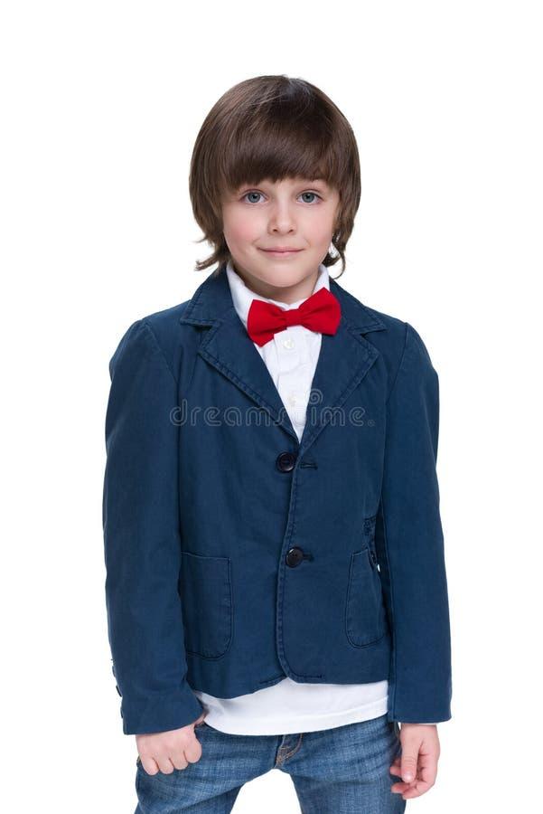 Mody chłopiec w niebieskiej marynarce fotografia royalty free