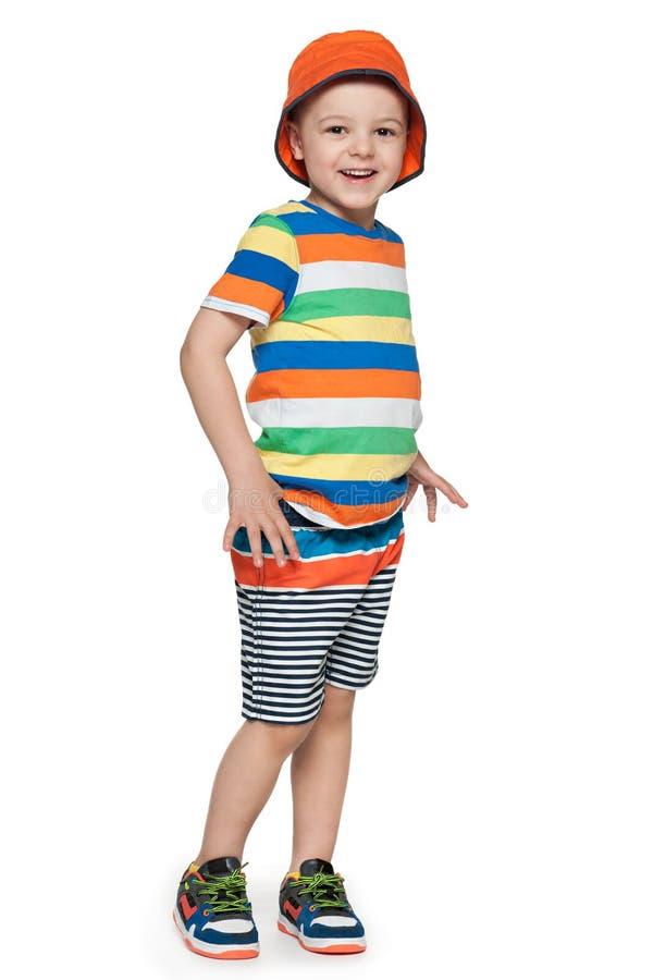 Mody uśmiechnięta chłopiec na bielu obraz royalty free