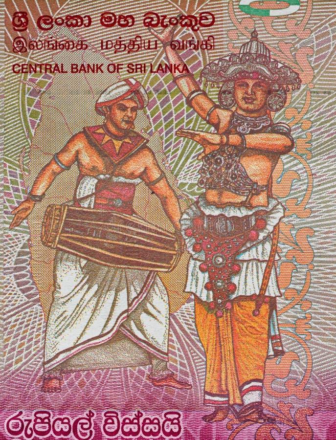 Moeda cingalesa macro da cédula de 20 rupias, dançarinos de Sri Lanka, imagens de stock royalty free