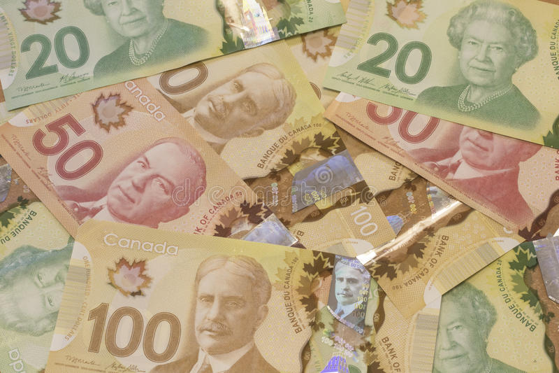 Moeda/contas do dólar canadense fotos de stock