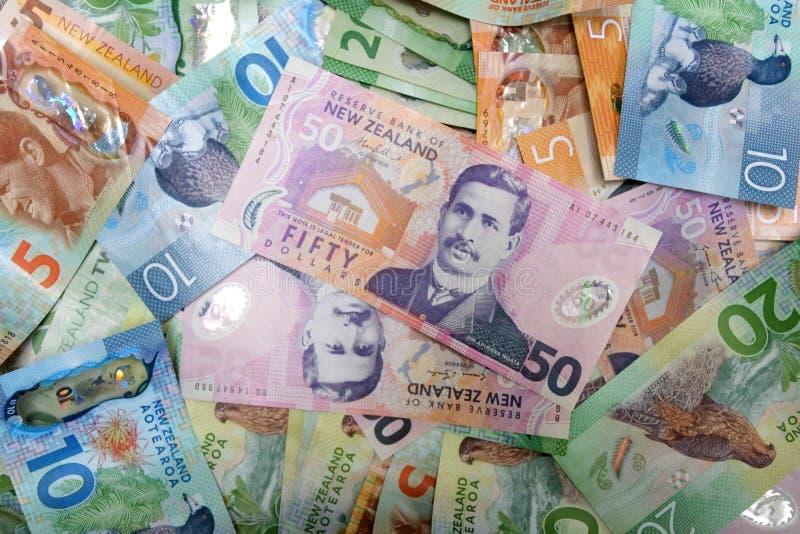 A moeda de Nova Zelândia nota o fundo fotografia de stock