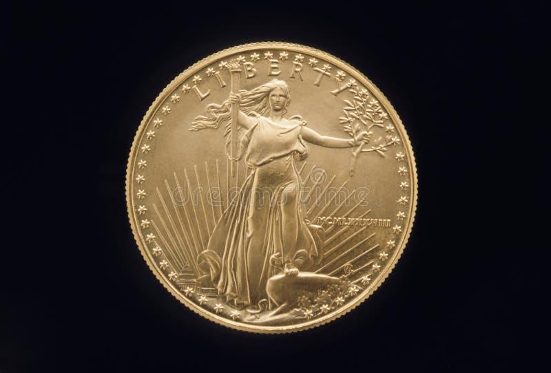 Moeda de ouro da liberdade fotografia de stock