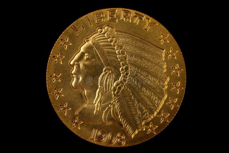 Moeda de ouro no preto fotos de stock royalty free