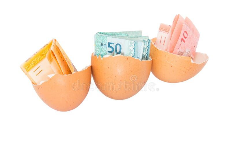 Moeda e cascas de ovo de Malásia II fotografia de stock royalty free
