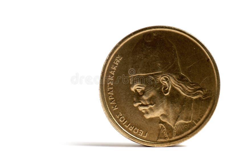 A moeda grega em uma tabela branca? fotografia de stock royalty free
