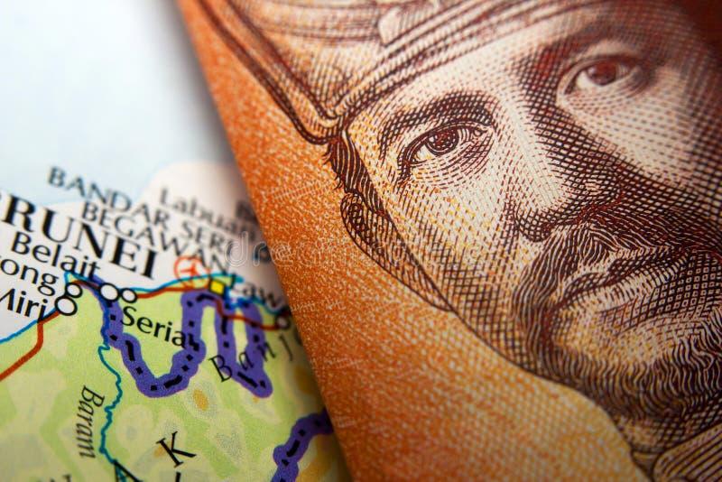 Moeda & mapa de Brunei Darussalam imagens de stock royalty free