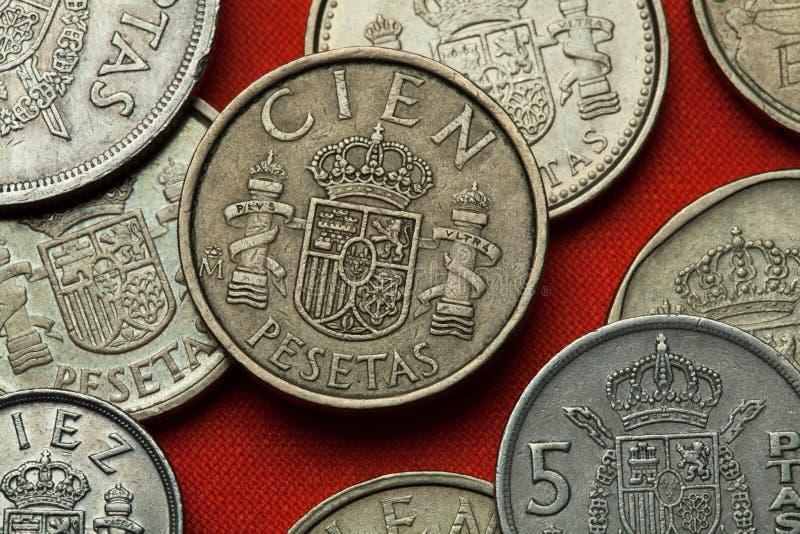 Moedas da Espanha Emblema nacional espanhol imagem de stock royalty free