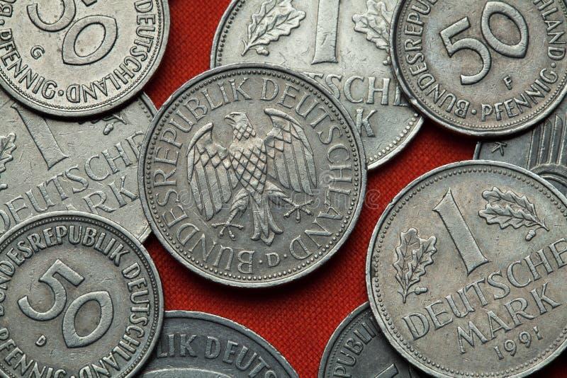 Moedas de Alemanha Águia alemão fotos de stock royalty free