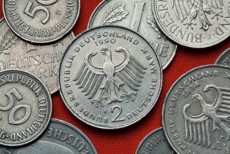 Moedas de Alemanha Águia alemão fotografia de stock royalty free