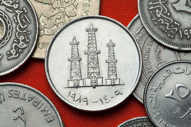 Moedas de Emiratos Árabes Unidos Torres de óleo fotografia de stock royalty free