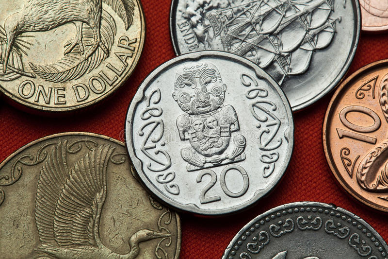 Moedas de Nova Zelândia Cinzeladura maori imagem de stock royalty free