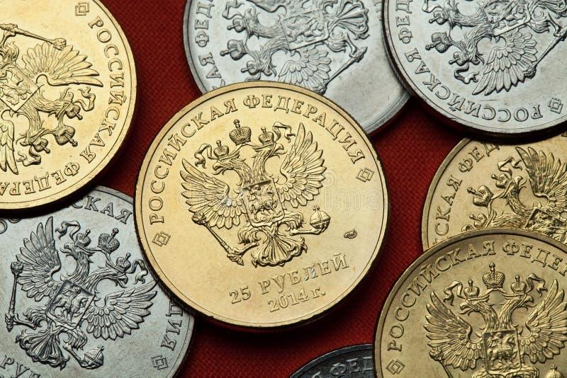 Moedas de Rússia O russo dobro-dirigiu a águia imagem de stock