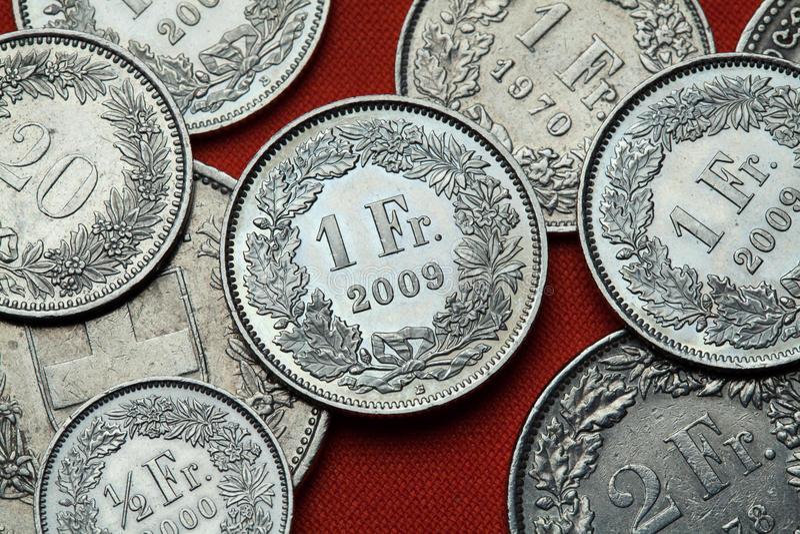 Moedas de Suíça foto de stock royalty free