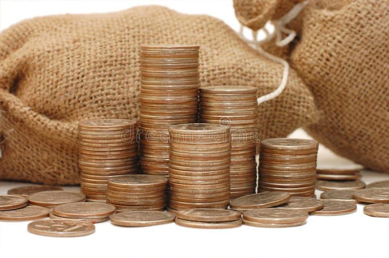 Moedas do dinheiro no saco fotos de stock royalty free