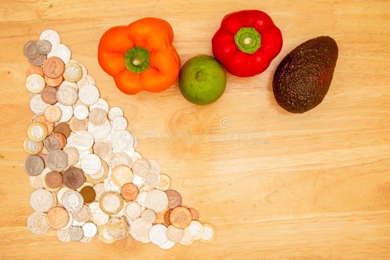 Moedas do Reino Unido e dos vegetais imagem de stock royalty free