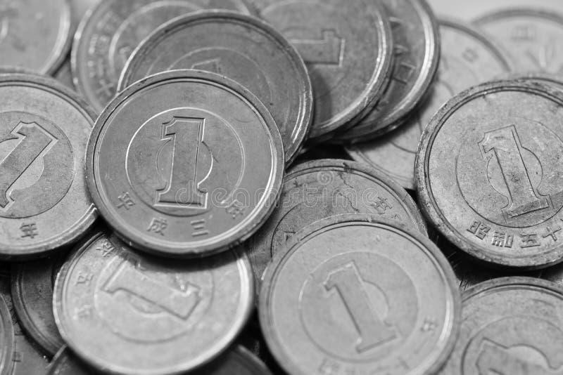 Moedas dos ienes japoneses imagem de stock
