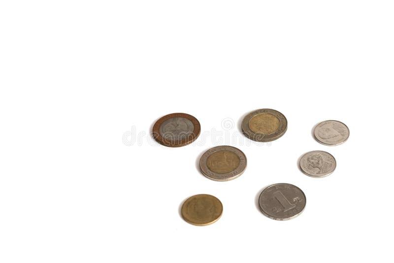Moedas isoladas em um fundo branco de valores diferentes imagens de stock royalty free