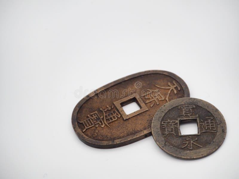 Moedas japonesas antigas imagem de stock