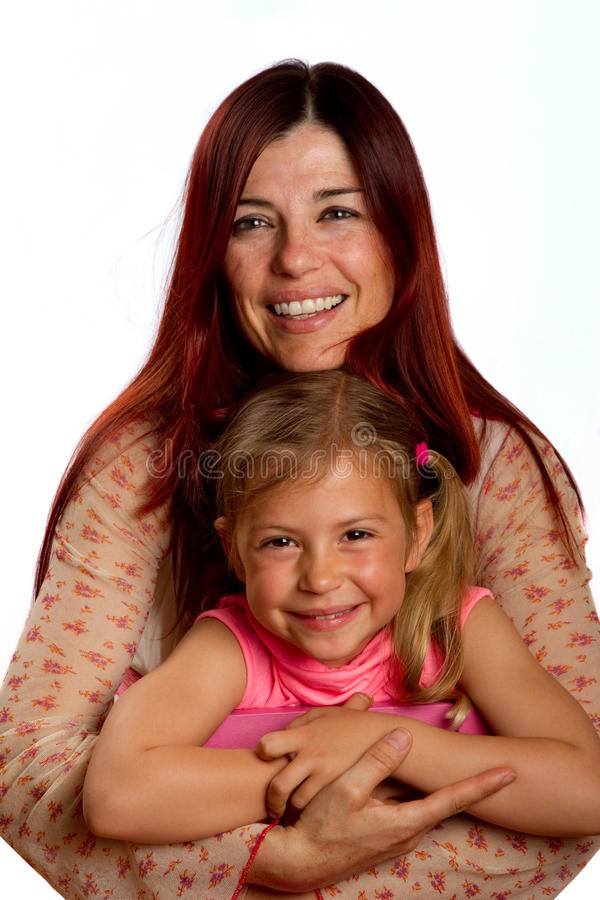 Moeder die dochter koestert royalty-vrije stock foto's