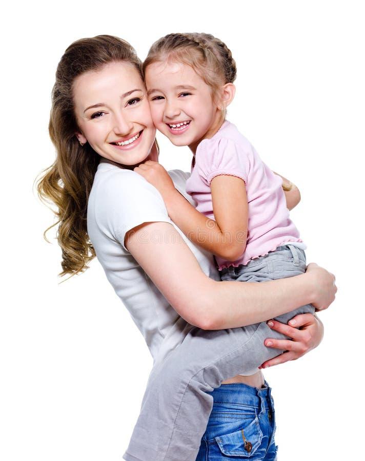 Moeder die weinig dochter houdt royalty-vrije stock afbeeldingen