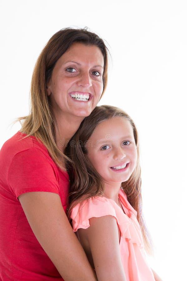 Moeder en dochter in liefdekind en van de schoonheidsvrouw meisje stock afbeelding