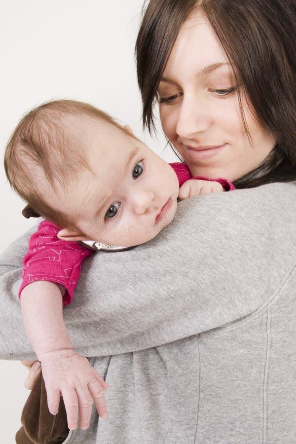 Moeder en haar baby stock afbeelding