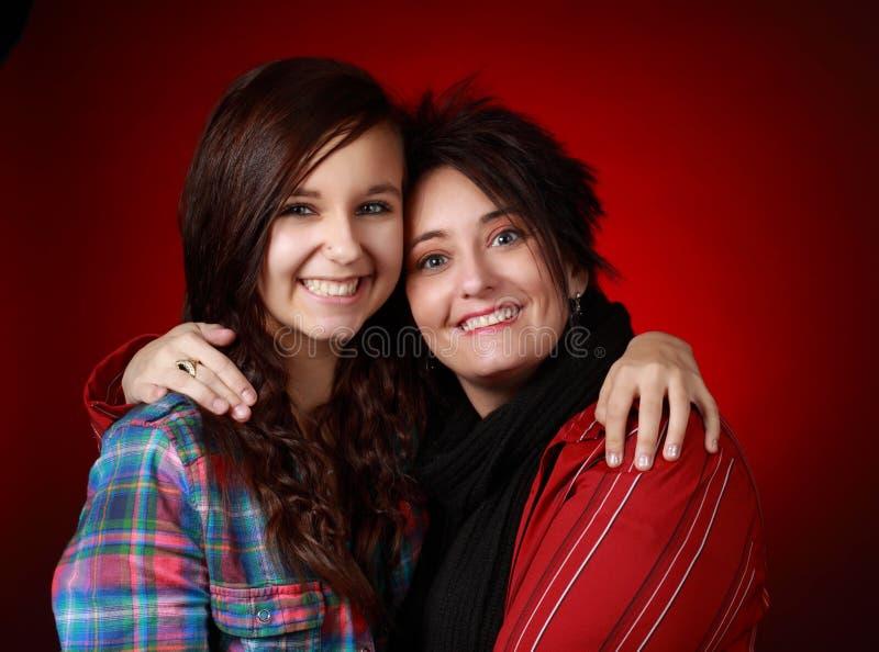 Moeder met haar tienermeisje stock afbeeldingen